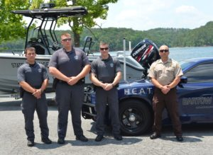 Members of the HEAT squad with Bartow County Sheriff Clark Millsap. ~~ Photograph by Robert Sutherland